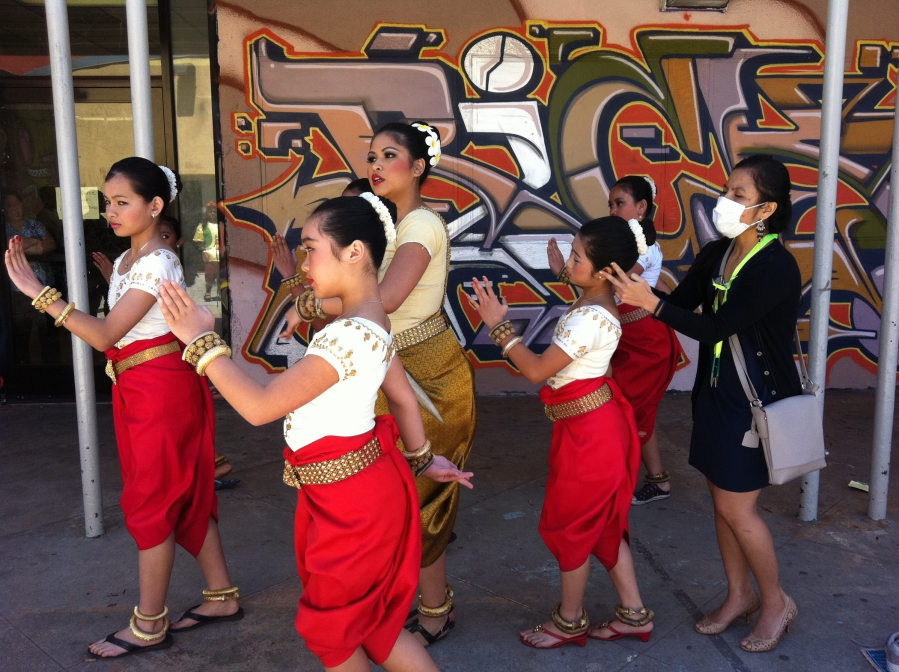 Artist-in-Residence Chankethya Chey (right) leading a warm up before a student performance at Long Beach's MacArthur Park.