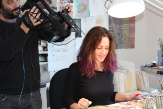 KQED - KQED Producer Matthew Williams films artist Wendy MacNaughton at her drawing table.JPG